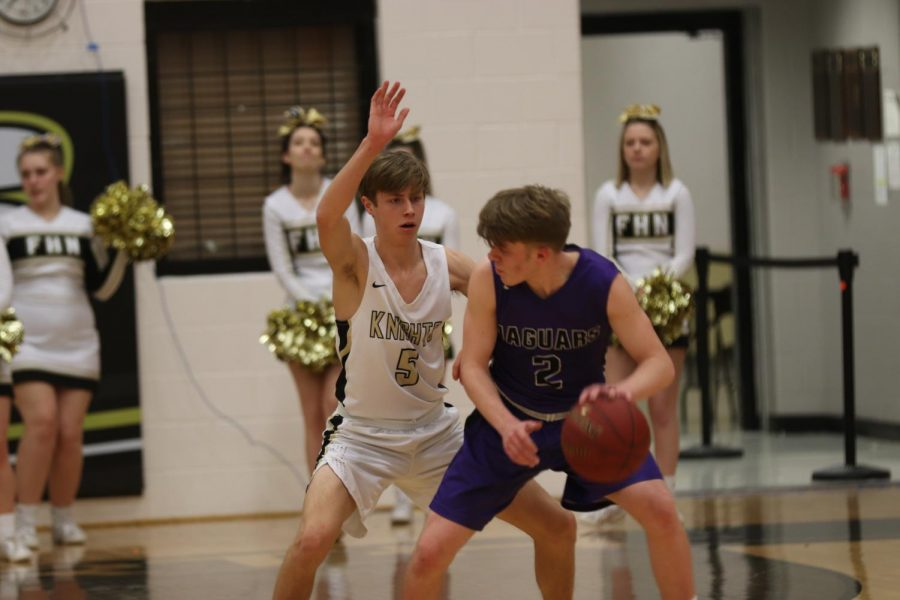 The opponent from Fort Zumwalt West tries to pass the ball but senior Ben Oster prohibits him from passing.