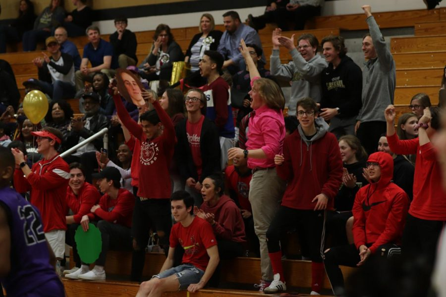 The schools non-official cheerleaders, The Goonies, cheers after the team scores a basket.