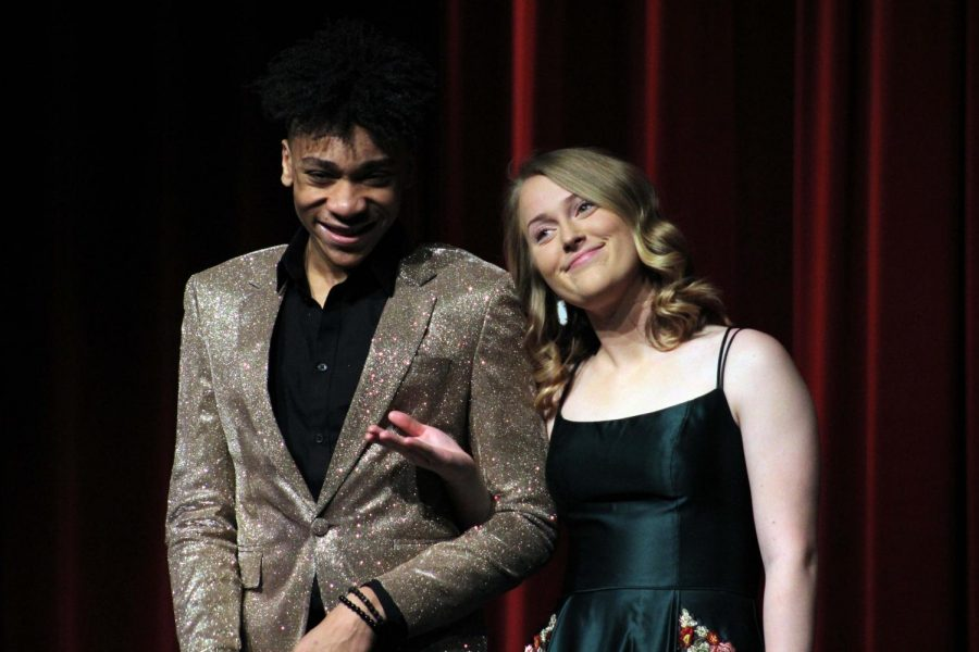 Seniors Anthony McDonald and Amelia Primeau, the hosts for the Prom Fashion Show, welcome the crowd.