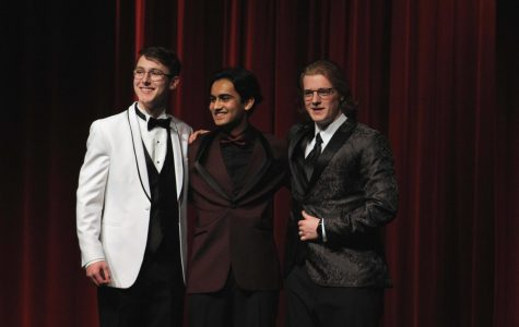 Louis Primeau, Tanay Parwal and Tom Jamison all show off their prom attire while laughing with their arms around each other.