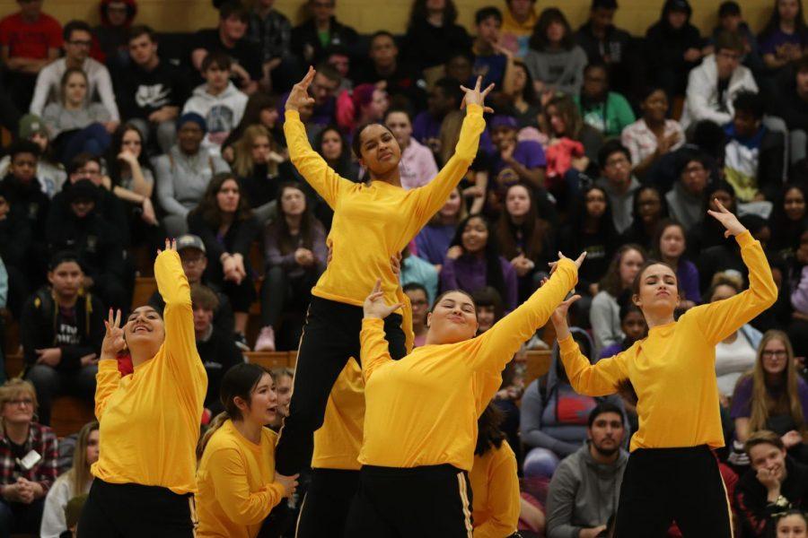 Junior Varsity Knightline strikes a fierce pose during their performance.