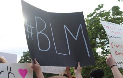 Protestors hold posters at a protest on Main Street, St. Charles, in support of the Black Lives Matter (BLM) movement. (Photo by Kaili Martin)
