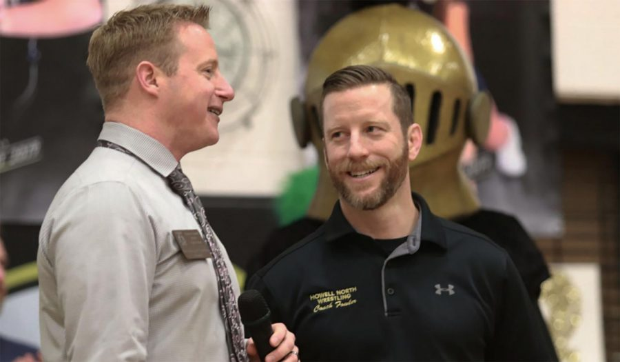 Head principal Nathanael Hostetler talks to Sean Fowler at an assembly.