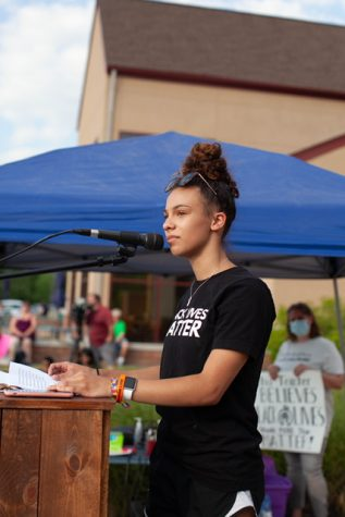 Mya Walker stands in front of hundreds of people as she gives her speech at the Calvary Church.