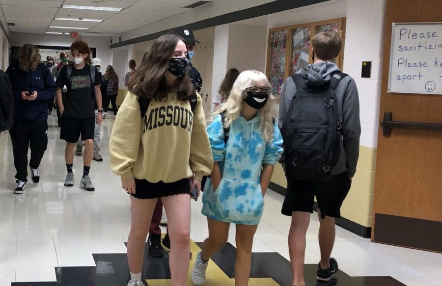 Students walk through the halls during passing period, wearing masks as per COVID-19 school protocol.