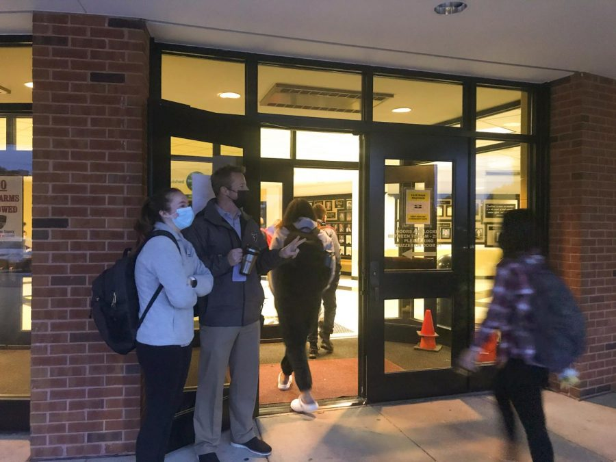 Head principal Nathanael Hostetler stands at the main door to welcome students into the school.