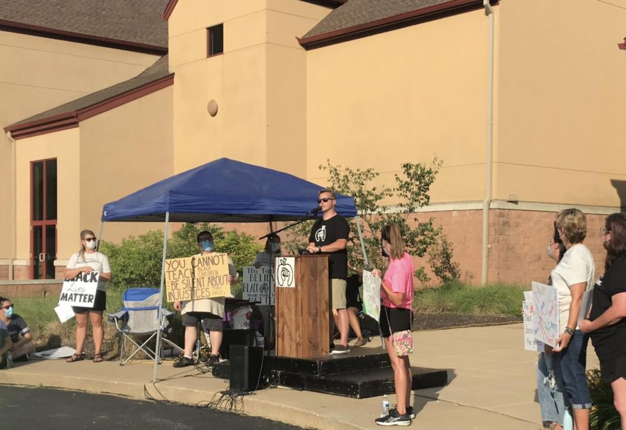 Head principal Nathanael Hostetler speaks at the Black Voices Matter march over the summer.
