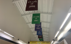 Senior banners hang on the ceiling of the top floor at FHN. Each banner is printed with both the senior class's year and their selected quote.