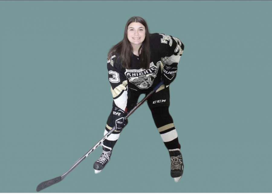 Sophomore Sarah Korte poses on the ice. HHer stick in hand and a smile on her face while wearing her Knights hockey jersey.