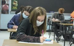 Students wear masks as they work in class. Black History and Black Literature will be new additions to the course catalogue as separate elective classes.