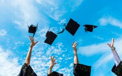 Four graduation caps are thrown into the air. Graduation will take place June 5. (Photo from Shutterstock)