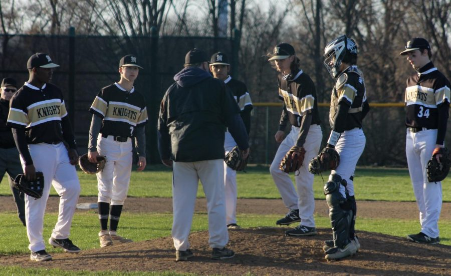 Varsity Baseball Defeated in Tough Game against the Battle Spartans [Photo Gallery]