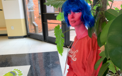 Monique sits in the front lobby. Students can take pictures with her and upload them to social media for the chance to win a prize.