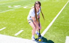 Junior Cat Connolly poses on the field.