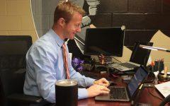 Head principal Nathanael Hostetler works at his computer.