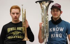 Seniors Robert Fairless and Anthony Davidson pose with their instruments.