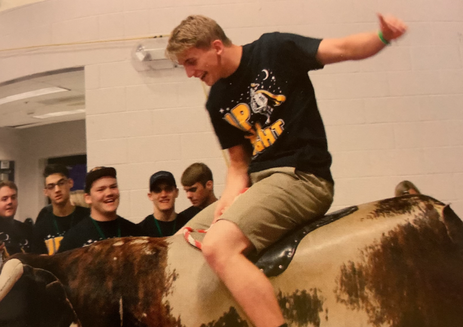 A senior rides a mechanical bull at the All-Knighter 2019. There was no All-Knighter last year due to the outbreak of COVID-19, and there will be significant changes this year.