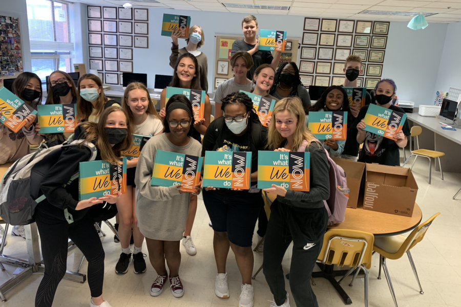 The yearbook staff poses with the 2021 yearbooks shortly after they arrive