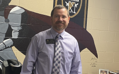 The new interim principal of Francis Howell North stands in his office