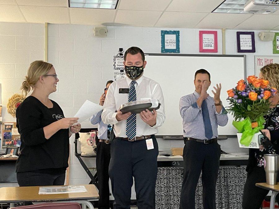FCS+teacher+Marissa+Heyer+accepts+award+from+Head+principal+Dr.+Lucas+Lammers