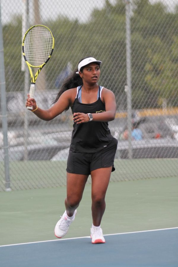 Varsity player Jayati Karre prepares to serve the ball to the other team. Previously at GACS, she placed 4th