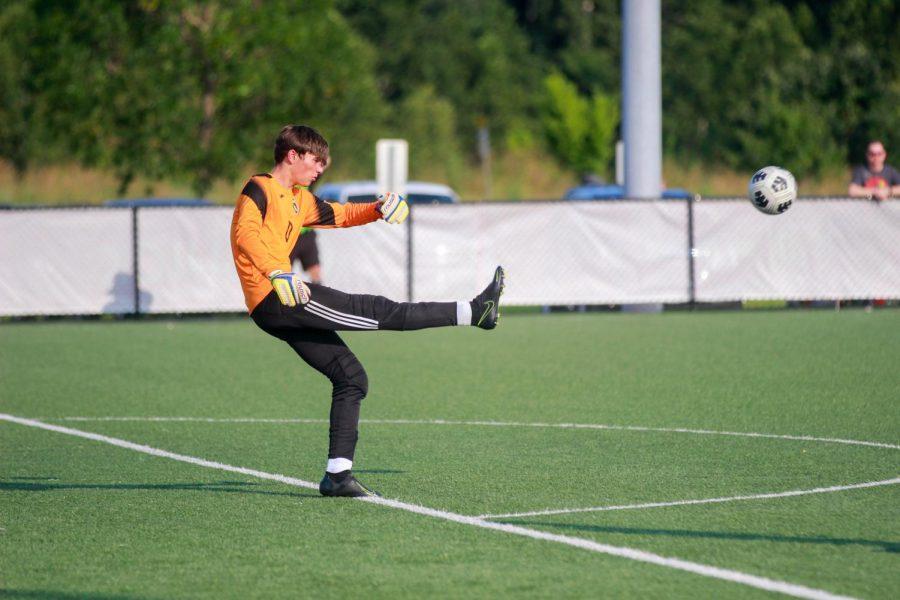 Senior Austin Bitter Kicks the Soccer Ball from the Goal Box