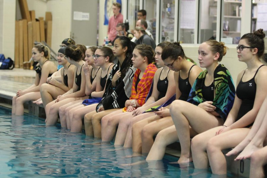 The+girls+varsity+swimming+team+prepares+for+a+meet+on+1%2F10+vs.+Francis+Howell.+
