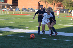 Freshman Sam Cary fights for the ball as it goes out of bounds (file photo)