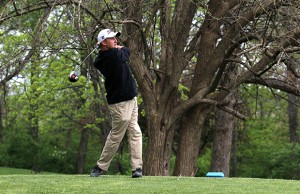 Ryan Hale swings his club back after hitting the ball. The boys golf team placed 3rd in last year's Districts.(File Photo)