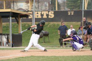 boys swings bat at a pitch