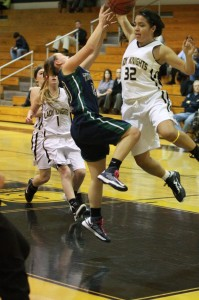 Senior Hali Long blocks a shot during a game.