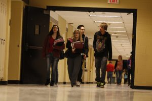 Students who just arrived at school still walk through the halls, even after the 7:20 bell rang. (photo by cameron mccarty)