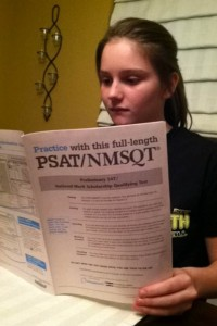 Sophomore Kailyn Bowman studies for the PSAT using the PSAT prep book. (file photo)