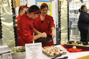 Senior Daniel Ingle serves the dish he made during the competition. (abby temper)