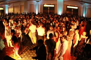 """Students gather around to dance on the dance floor at last years prom, themed """"A Night in Vegas""""."""