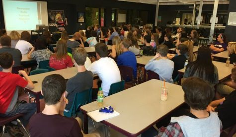 Student listen to a guest speaker at FHN Jcamp during one of their mini-sessions.