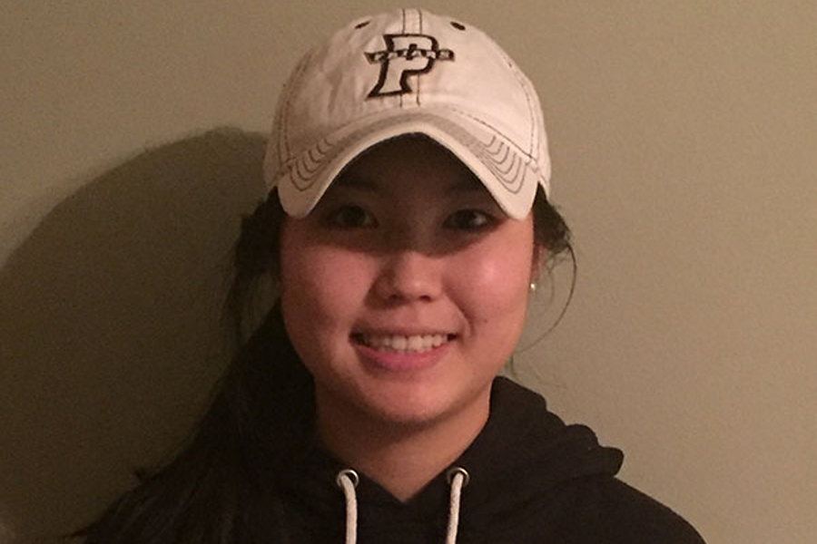 Senior+Yuri+Takenaka+poses+in+a+Providence+University+hat+and+hoodie.+%28Photo+submitted%29