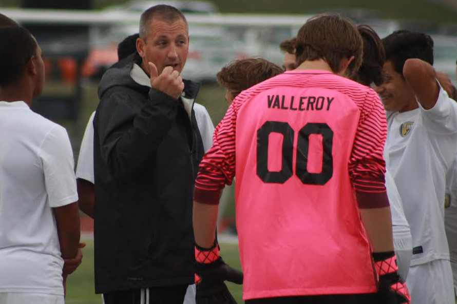 Coach+Larry+Scheller+talks+to+the+team+during+the+soccer+game+vs+Howell+on+Sept.+12.