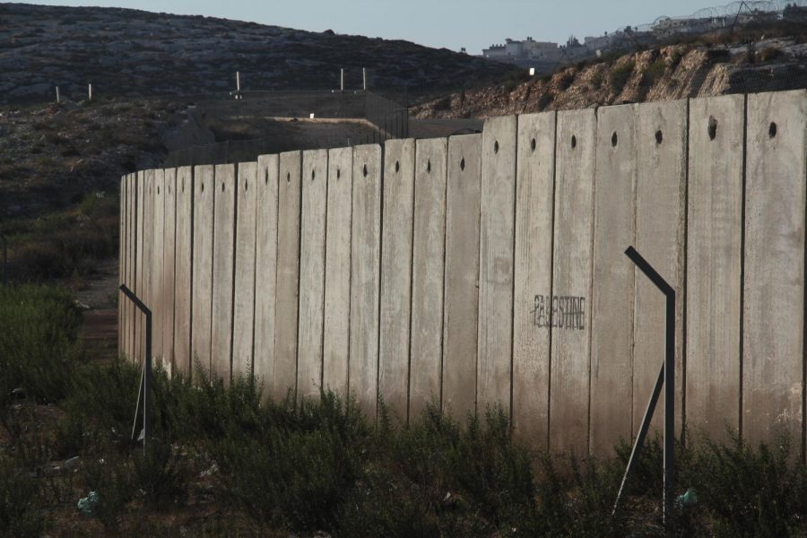 A section of the concrete Israeli West Bank barrier wall, with the world